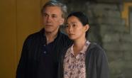 Hong Chau plays Ngoc Lan Tran and Christoph Waltz plays Dusan Mirkovic in Downsizing from Paramount Pictures.