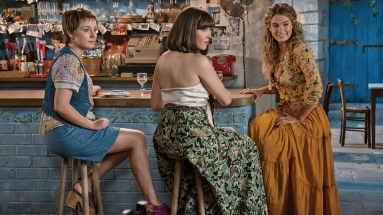 """(L to R) Young Rosie (ALEXA DAVIES), Young Tanya (JESSICA KEENAN WYNN) and Young Donna (LILY JAMES) in """"Mamma Mia! Here We Go Again."""" Ten years after """"Mamma Mia! The Movie,"""" you are invited to return to the magical Greek island of Kalokairi in an all-new original musical based on the songs of ABBA."""